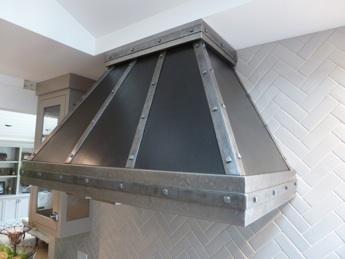 zinc-range-hood-2-tone-patina-16193614228-o.jpg